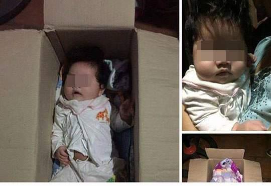 HN: Bé gái kháu khỉnh bị bỏ rơi trong thùng giấy trước cửa nhà dân 1